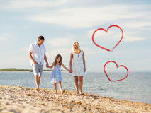 Happy family walking at the seaside Stock Images