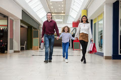 Happy family walking with shopping bags Stock Photos