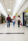 Happy family walking with shopping bags Royalty Free Stock Photos