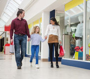 Happy family walking with shopping bags Stock Image