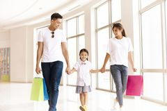 Happy family walking in the shopping mall royalty free stock photos