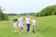Happy family walking spending time outside Stock Image