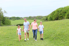 Happy family walking spending time outside. Family walking on country trail during vacation time stock images