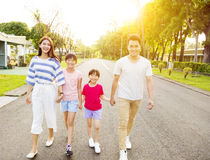 Happy  family walking on the street Stock Image