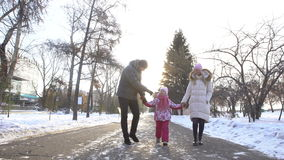 Happy family walking on the street together. stock video footage