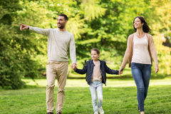 Happy family walking in summer park Stock Photo
