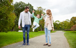 Happy family walking in summer park and having fun Royalty Free Stock Photos
