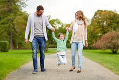 Happy family walking in summer park and having fun Royalty Free Stock Photography