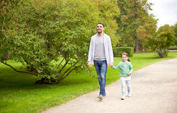 Happy family walking in summer park Stock Image