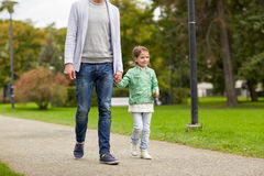 Happy family walking in summer park Royalty Free Stock Photography