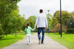 Happy family walking in summer park Royalty Free Stock Photo