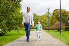 Happy family walking in summer park Stock Photo