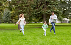 Happy family walking in summer park Royalty Free Stock Photos