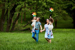 Happy family walking in summer park. Happy family walking playing in summer park Royalty Free Stock Images