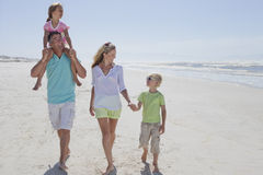 Happy family walking on sunny beach Royalty Free Stock Image