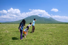 Happy family walking to the mountain. While holding hands Royalty Free Stock Images