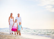 Happy Family Walking Together by the Beach Stock Photos