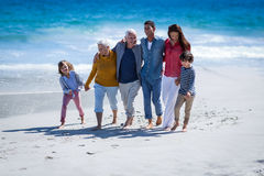 Happy family walking together. At the beach Stock Photos