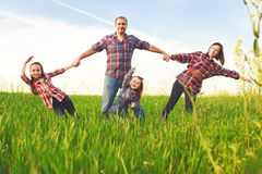 Happy family walking together Royalty Free Stock Photography