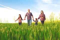 Happy family walking together Royalty Free Stock Image