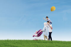 Happy family walking together in the meadow Royalty Free Stock Image