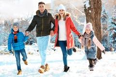 Happy family walking in   park. Happy family walking in winter park Royalty Free Stock Photos