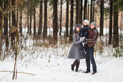 Happy family walking in a winter park. royalty free stock photos