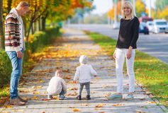 The happy family walks in the city autumn park Stock Photography