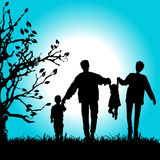 Happy family walks on nature Royalty Free Stock Photo