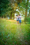 Happy family walks in the park Stock Photography