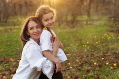 Happy family walks in the spring meadow stock image