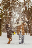 Happy family in warm clothing. Smiling mother and son playing fun game outdoor. The concept of winter activities Royalty Free Stock Photography