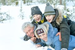 Happy family in warm Royalty Free Stock Image