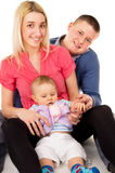 A happy family was sitting on the floor Stock Image