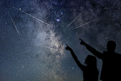 Happy family are watching Meteor Shower. Nigh Sky. Meteor Shower stock images