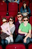 Happy family watching a movie Royalty Free Stock Photo