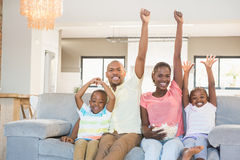 Happy family watching television eating popcorn Stock Images