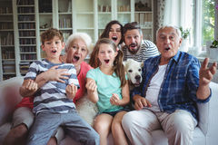 Happy family watching television in living room stock photos
