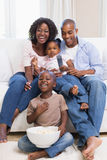 Happy family watching television together Royalty Free Stock Images