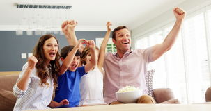 Happy family watching tv in living room stock footage