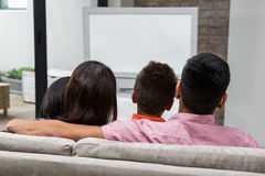 Happy family watching tv on the sofa Royalty Free Stock Images