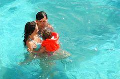 Happy family in water. Happy family with little child in water Royalty Free Stock Image