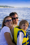 Happy family on water. Cute family with big smiles.  Water background Stock Image