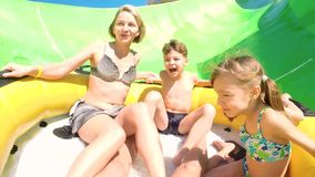 Happy family on water slide stock video