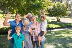 Happy family waving at camera Stock Photography