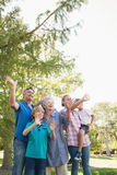 Happy family waving hands in the park Royalty Free Stock Photos