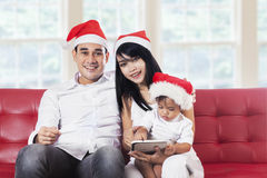 Happy family wearing christmas hat Stock Photography