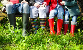 Happy family wearing colorful rain boots Stock Photography