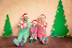 Happy family holding Christmas gift boxes Royalty Free Stock Image
