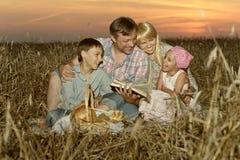 Happy family on wheat field Stock Photography